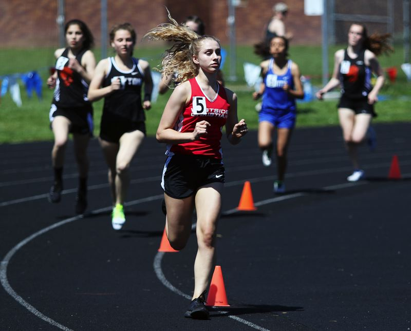 TIMES PHOTO: DAN BROOD - Westside Christian freshman Morgan Petersen ran to victory in the 800-meter run at the West Valley League district track and field meet.