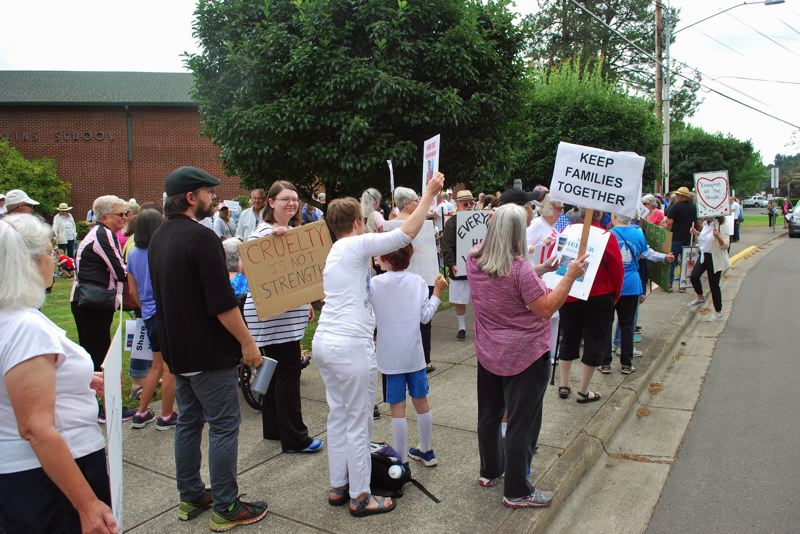 PHOTO COURTESY MADDIE GAVEL-BRIGGS AND PATRICK BRIGGS  - Sherwood residents rally in opposition to separating families at the U.S. southern border.