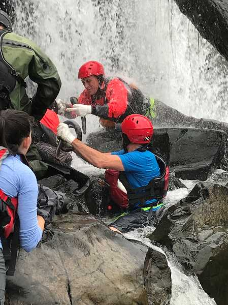 REVIEW PHOTO: PATRICK MALEE - Torey Wakeland (middle) snags a lamprey from the rocks at Willamette Falls.