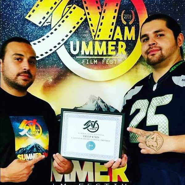 SUBMITTED PHOTO - Award-winning Producer Isaac Trimble and Director LaRonn Katchia hold a certificate in recognition of their contributions to the July 14 Warm Springs Summer Jam Film Fest.