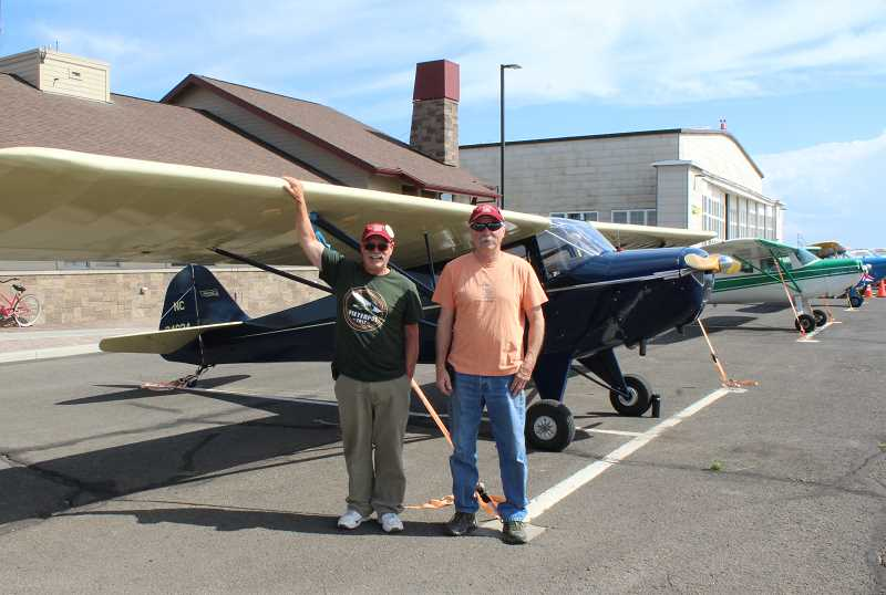 HOLLY M. GILL - Members of the Oregon Antique and Classic Aircraft Club, Mark Baxter, left, and Tim Talen, were among 17 visitors to Madras on Monday. Baxter flew in to the airport in his 1941 Taylorcraft and Talen, in his 1941 Interstate. On Tuesday, the group left for its next stop, Joseph, in Eastern Oregon.