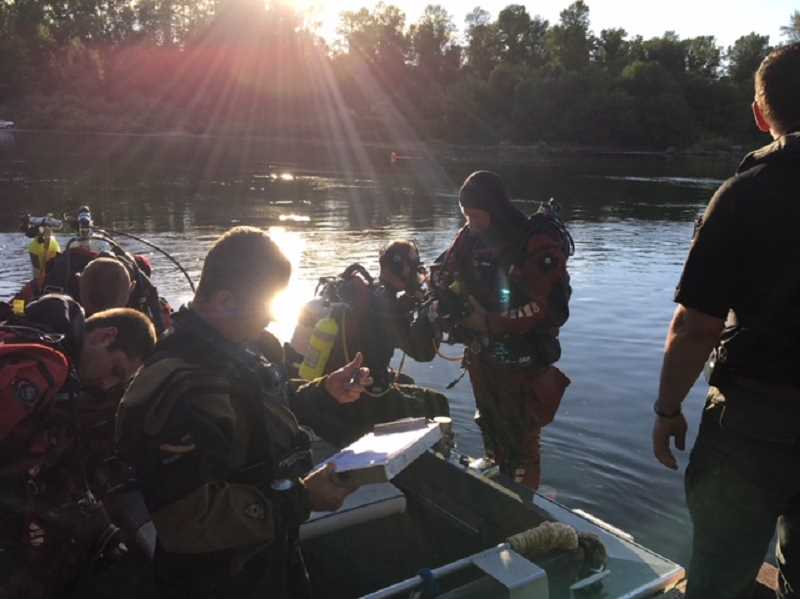 COURTESY PHOTO: YAMHILL COUNTY SHERIFF'S OFFICE - Search and rescue teams prepare to look for a swimmer who went missing Wednesday afternoon in the Willamette River near the Wheatland Ferry.