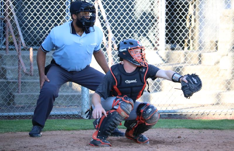 PAMPLIN MEDIA: JIM BESEDA - Gladstone's Ben Hill has taken over full-time catching duties for the defending Class 4A state champion Gladiators, replacing Otis Lundgren.