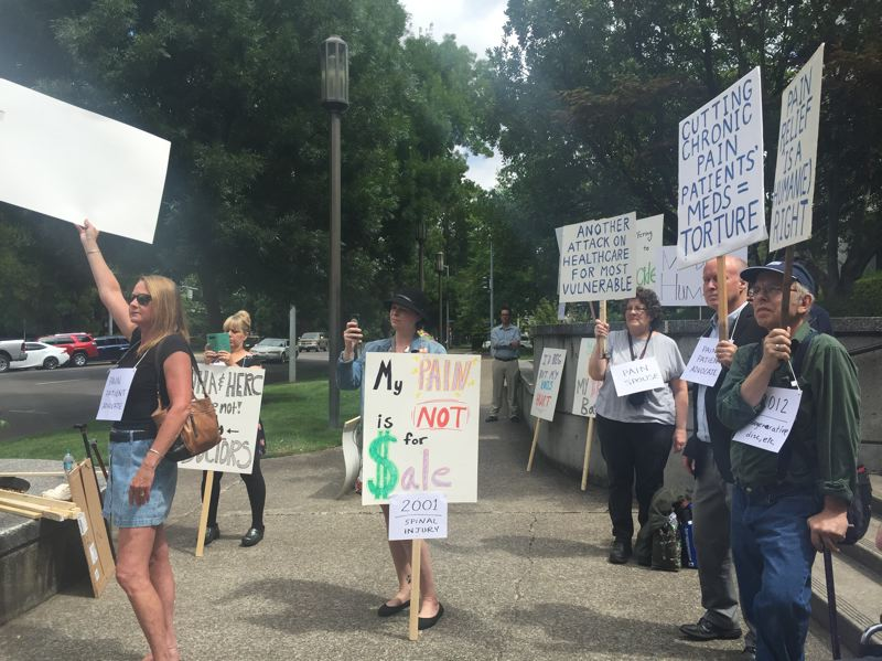 PARIS ACHEN/CAPITAL BUREAU - Chronic pain patients and their supporters demonstrate outside Oregon Heath Authority offices in Salem July 19, 2018.