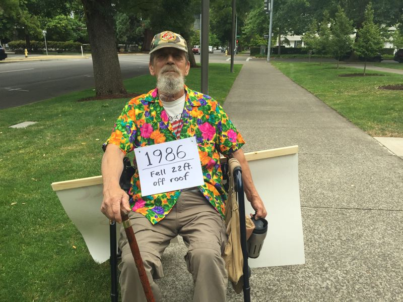 PARIS ACHEN/CAPITAL BUREAU - Tim Harless of Tigard demonstrates in support of opioid access for chronic pain patients during an event at the Oregon Health Authority office in Salem July 19, 2018.