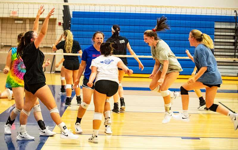 LON AUSTIN/CENTRAL OREGONIAN - Members of the Cowgirl volleyball team celebrate after a key point in the Rimrock Volleyball Team Camp championship match. The Cowgirls fell to the Class 6A Sandy Pioneers in a tight three-set match.