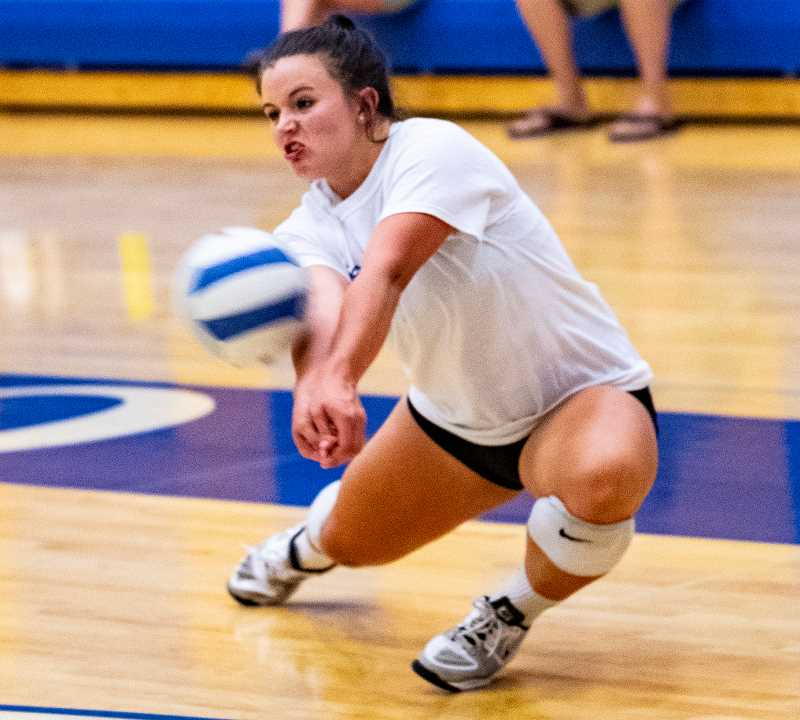 LON AUSTIN/CENTRAL OREGONIAN - Mekynzie Wells digs a hard spike during the Cowgirls' match against Sandy at the Rimrock Team Camp.
