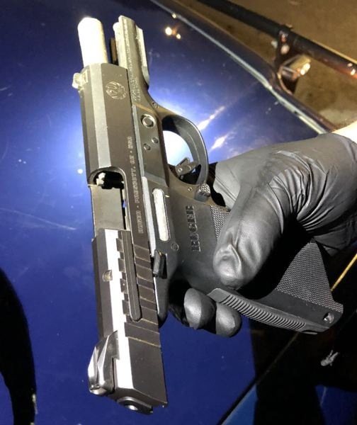 POLICE PHOTO - This firearm was found inside the backpack of a juvenile suspect, police say.