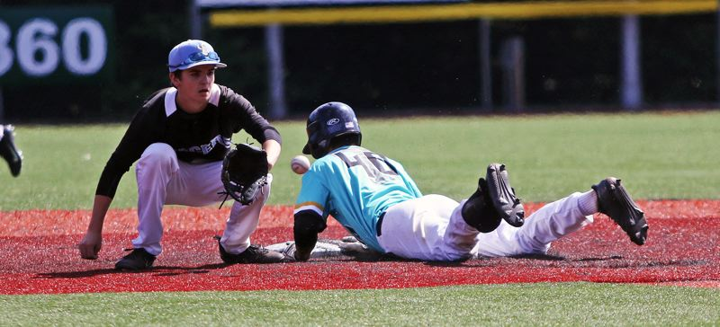 TIMES PHOTO: DAN BROOD - Tualatin's Jett Searle (right) dives to second base for a double during Thursday's OIBA tournament game with Lakeridge.