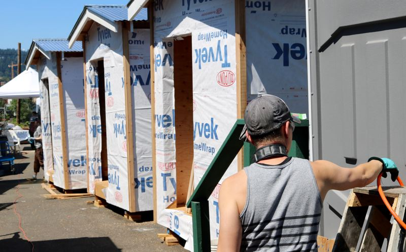 TRIBUNE PHOTO: ZANE SPARLING - A volunteer works on the new sleeping pods under construction at Right 2 Dream Too on Saturday, July 21.