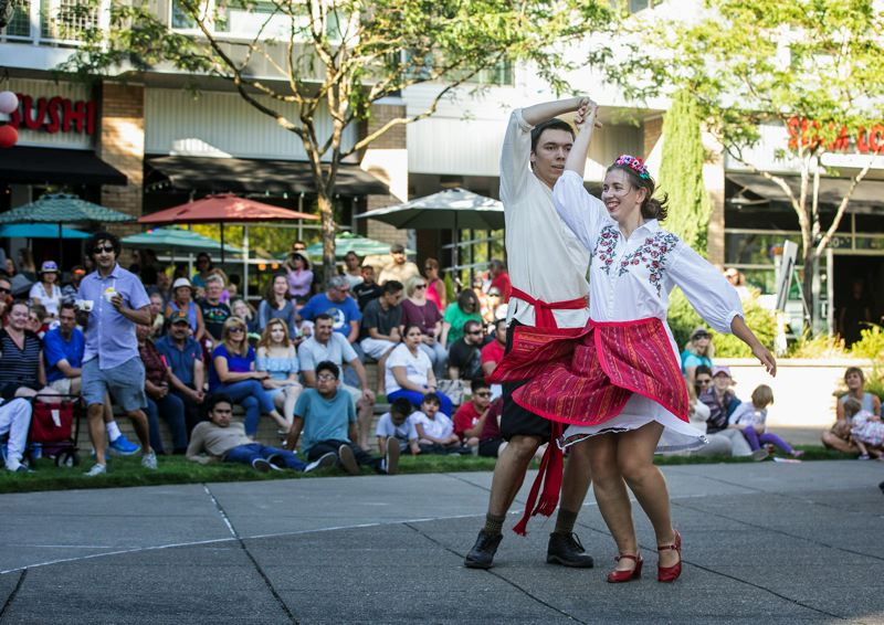 TIMES PHOTO: JONATHAN HOUSE - Anton Liakhovitch and Julia Paradnaya perform as part of the Scarlet Sails Russian Russian Theater Group at the Beaverton Night Market.
