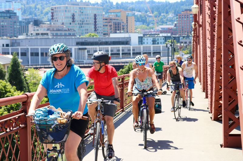 TRIBUNE PHOTO: ZANE SPARLING - Cyclists battle the uphill stretch of the Broadway Bridge on Sunday, July 22 in Portland.