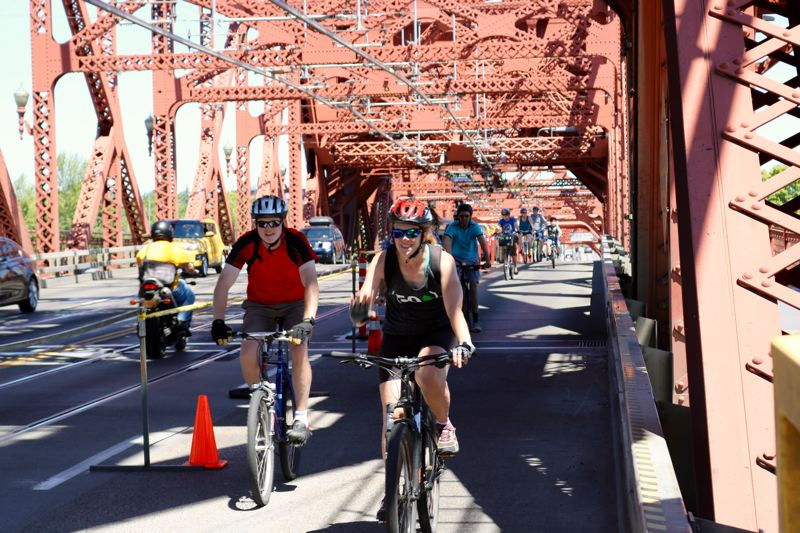 TRIBUNE PHOTO: ZANE SPARLING - A lane of the Broadway Bridge was closed to car traffic as cyclists filled the streets for Sunday Parkways on July 22.