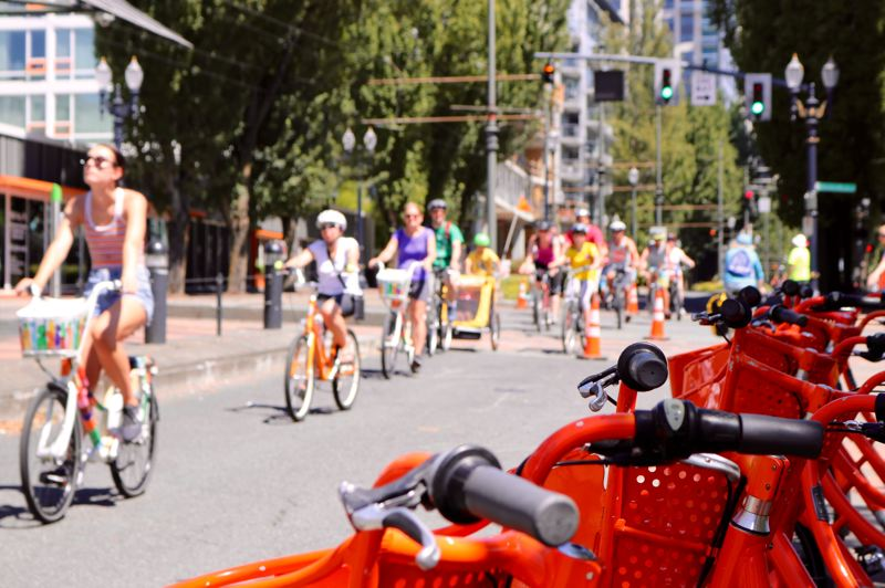 TRIBUNE PHOTO: ZANE SPARLING - Many people could be seen using Biketown bikes on Sunday, July 22 during a preview of Portland's Green Loop.