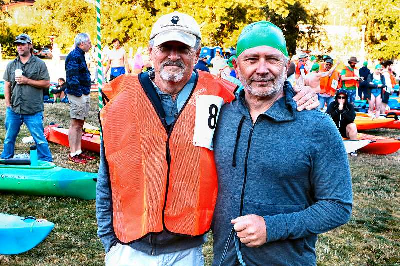 DAVID F. ASHTON - Accompanied by his assigned kayaker, Richard Moore, here is Southeast Portlands 70-year-old David Poulshock - the oldest swimmer in the annual race - and again ready to take on the Portland Bridge Swim.
