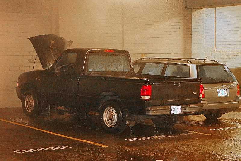 DAVID F. ASHTON - Quick firefighter response, and a working sprinkler system that kept spraying even after the blaze was out, saved the other vehicles under the Powell Boulevard Safeway when this pickup truck caught fire in the stores parking basement.