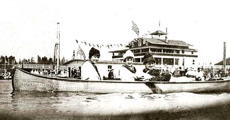 COURTESY OF OREGON YACHT CLUB - Three young women in a canoe in 1906, shown in front of the Oregon Yacht Clubs clubhouse. The Oregon Yacht Club started its Annual Labor Day Regatta in 1900, and this might have been taken on Labor Day - clearly, it was a nippy Northwest day, since these girls are wearing stocking caps and not summer hats.