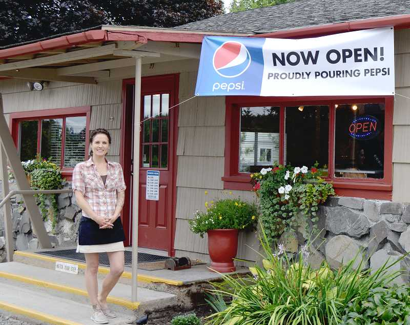 PIONEER PHOTO: CINDY FAMA - Owner Amy Hall stands outside the newly re-opened Colton Cafe.