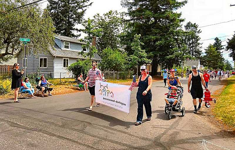 COURTESY OF CHELSEA POWERS  - This years Brentwood-Darlington Independence Day unofficial parade proceeded on foot along S.E. Ogden Street.