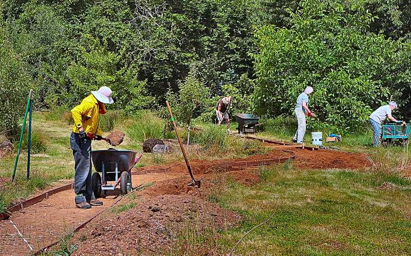 DAVID F. ASHTON - Volunteers from the Multnomah County Master Gardeners program worked to complete a path from the new Annex Garden to S.E. 57th Avenue.