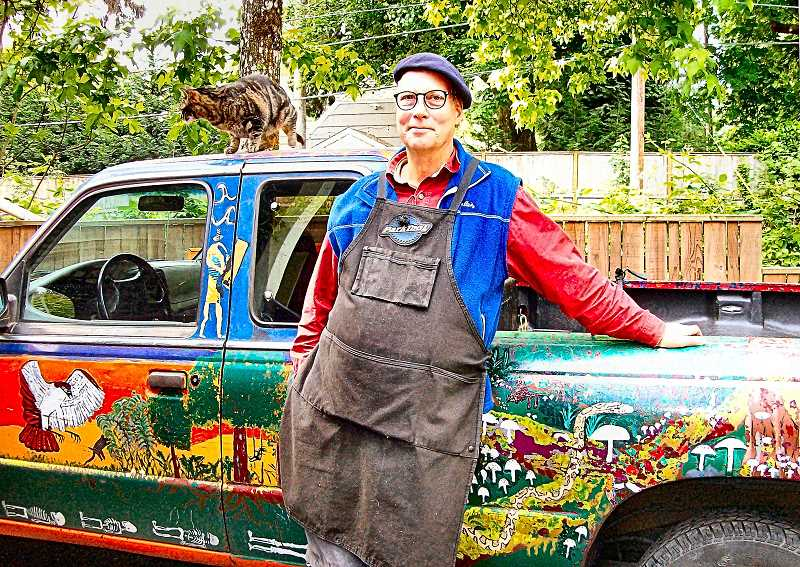 RITA A. LEONARED - Tim Calvert and his cat, Ruby, pose with the new nature scenes hes painted on the left side of his pickup truck.