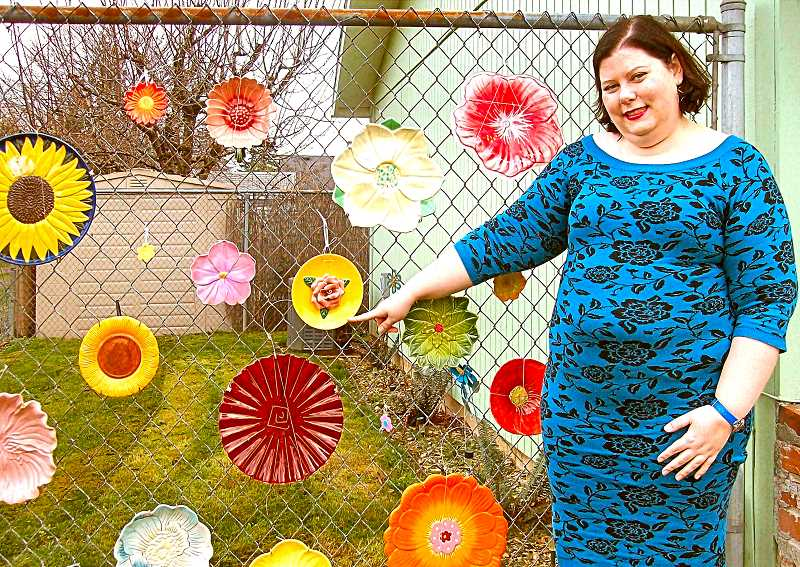 RITA A. LEONARD - Teacher Samantha Breen has created a flower fence at her home on S.E. 69th Avenue - but the flowers shes displaying are actually recycled ceramic plates.