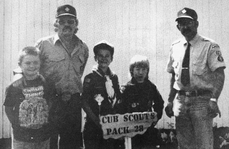 CENTRAL OREGONIAN FILE PHOTO  - July 22, 1993: Cub Scouts Pack 28 gathered at Crook County Fairgrounds on June 13 to clean up an area donated to the pack by the fairgrounds. Pack members pulled weeds, pruned and raked garbage. Next, they planted flowers and a shrub. Scouts were Buster Dixon and David Haye. Also participating were cubmaster Alonzo Haye and family, and assistant cubmaster Floyd Mergel, with help from Ben Mergel.