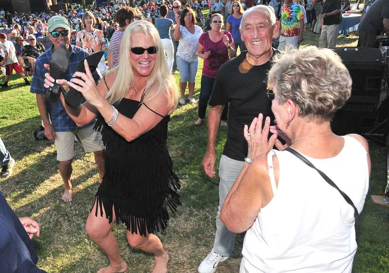 Johnny Limbo and the Lugnuts band member Barbara Cecil joins the crowd with a dance.