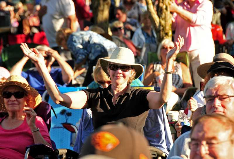 Elizabeth Peter keeps time with the music at the Wilsonville Rotary Summer Concert July 19..