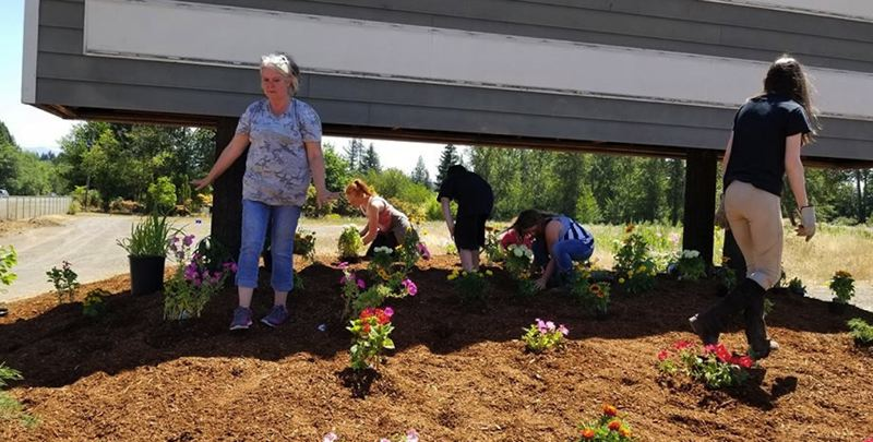 CONTRIBUTED PHOTO - July 21 Samantha MacDonald and Valerie Teeters hosted friends and family cleanup day at the Mt. Hood Equestrian Center.