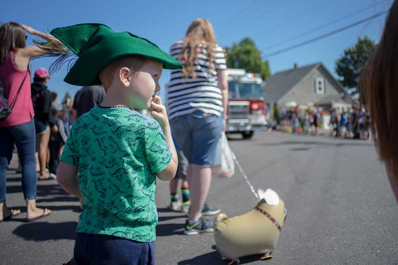 GAZETTE PHOTO: KIT MACAVOY - Signature green feather caps are sold in droves each year at the Robin Hood Festival.