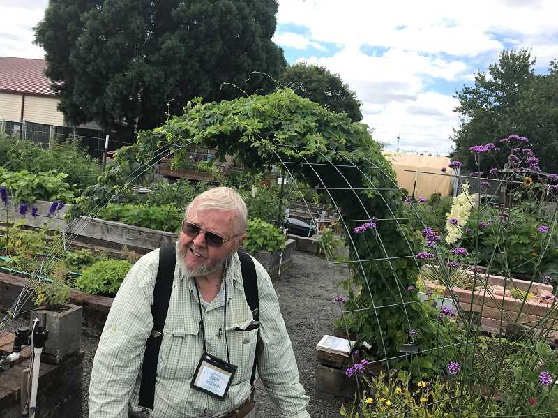 STAFF PHOTO: GEOFF PURSINGER - Jerry Anderson, of Forest Grove, tours the Tualatin Valley Garden Club demonstration garden at the Washington County Fair Complex. The garden will be demolished later this year after 30 years on the property.