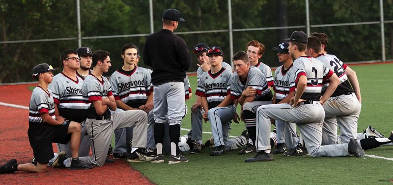 TIMES PHOTO: DAN BROOD - Sherwood coach Nate Hickok talks with his team following Friday's quarterfinal game at the OIBA tournament.