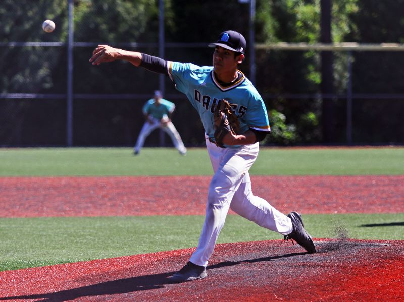 TIMES PHOTO: DAN BROOD - Tualatins Jett Searle fires in a pitch during the teams OIBA tournament quarterfinal game with West Linn on Friday.