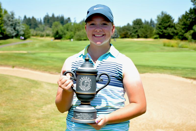 PHOTO COURTESY OGA - Victoria Gailey, a Tigard High School graduate, holds the Oregon Junior Stroke Play championship trophy that she won.