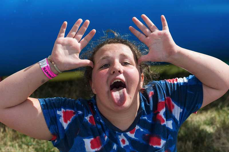 STAFF PHOTO: CHRISTOPHER OERTELL - Jennica Gonzales, 13, made the drive from Eastern Washington last year to have fun at the Washington County Fair.