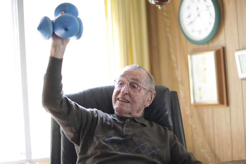 TIMES FILE PHOTO: JAIME VALDEZ - Curtis Tigard chatted about his long life with a Tigard/Tualatin Times reporter in 2010. Tigard attended Beaverton High School because Tigard had yet to build a school. He said that lifting two 5-pound weights as part of his daily exercise kept him young.