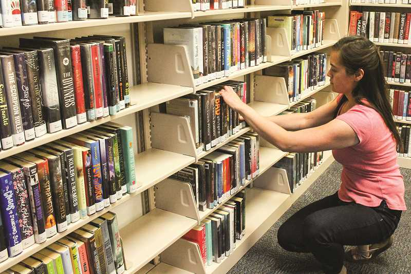 HOLLY SCHOLZ - Crook County Library Youth Services Librarian Shun-Sho Fong said the young adult collection was recently given a very thorough weeding, which eliminated books that had not been checked out in a few years as well as damaged copies.