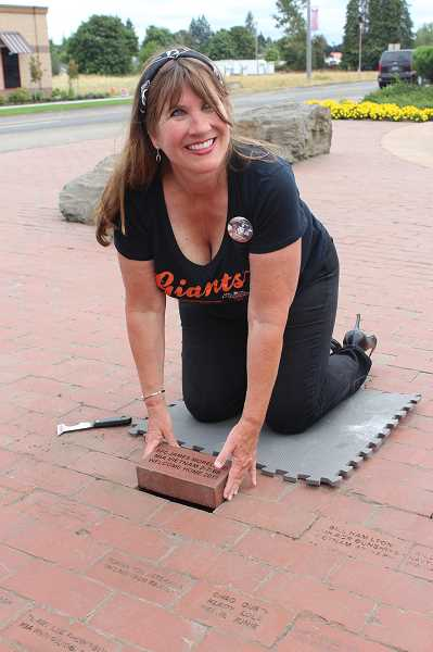 HERALD PHOTO: KRISTEN WOHLERS - The brick Strong placed in Oregon is her 14th in her endeavor to place a memorial brick for Moreland in every state.
