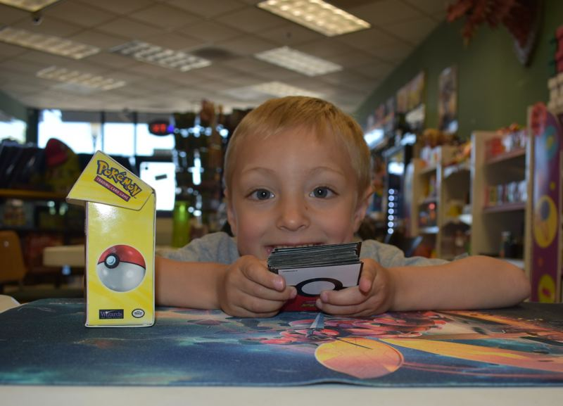 OUTLOOK PHOTO: TERESA CARSON - Ronan, 4, is anxious to learn to read so he can start playing Pokémon like his big brothers.
