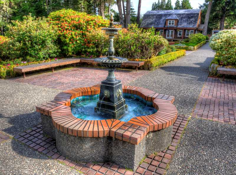 A fountain sits in the middle of the Louis J. Simpson Shore Acres Gardens.