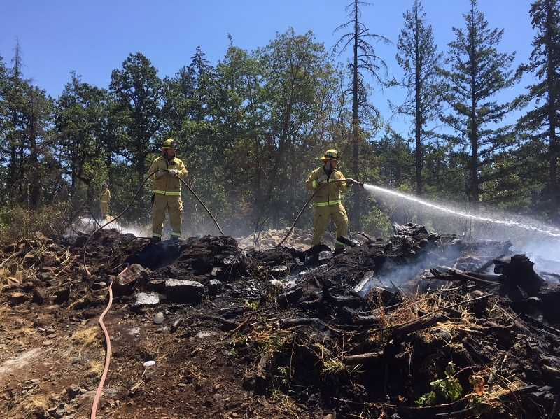 COURTESY TVF&R - A brush fire in Sherwood on Dalke Lane was quickly extinguished shortly after noon on Friday.