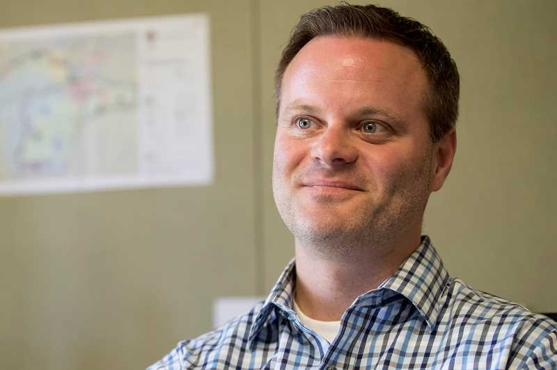 TIMES PHOTO: JAIME VALDEZ - Ross Hoover, the new Tualatin Parks and Recreation director, will oversee the citys trail systeam as well as its 36 parks.