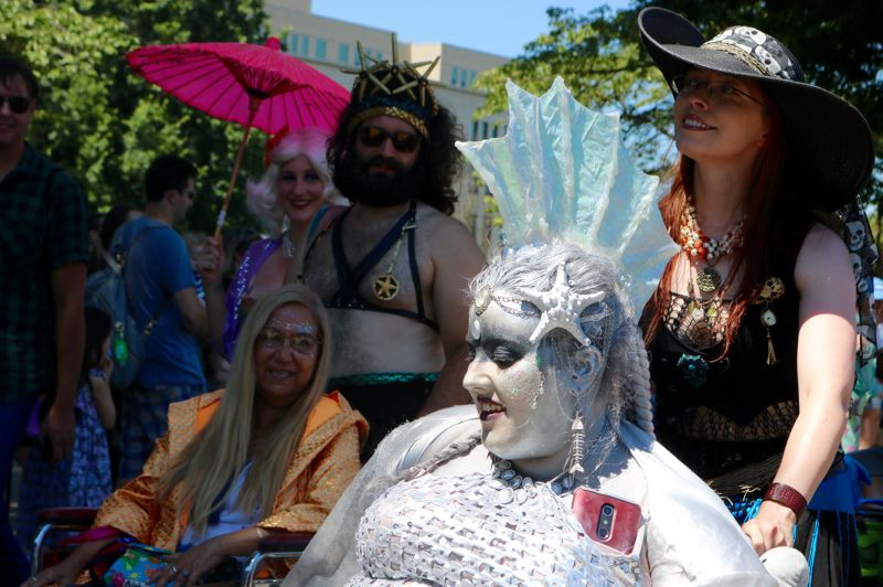 TRIBUNE PHOTO: ZANE SPARLING  - Ylluria WaterSong (center) moves along during the 2018 Portlandia Mermaid Parade.