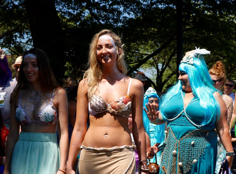 TRIBUNE PHOTO: ZANE SPARLING - Three mermaids walk along during the 2018 Portlandia Mermaid Parade in downtown Portland on Saturday, July 28.