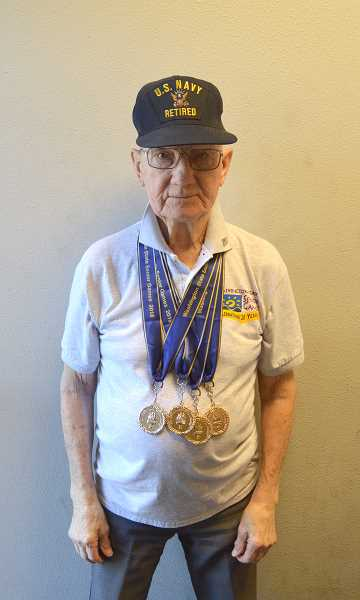 SPOTLIGHT PHOTO: DARRYL SWAN - Frank Weber, 94, has competed in 13 annual Washington State Senior Games, specifically in track and field events. Weber served in the U.S. Navy during World War II on the USS Coloardo.