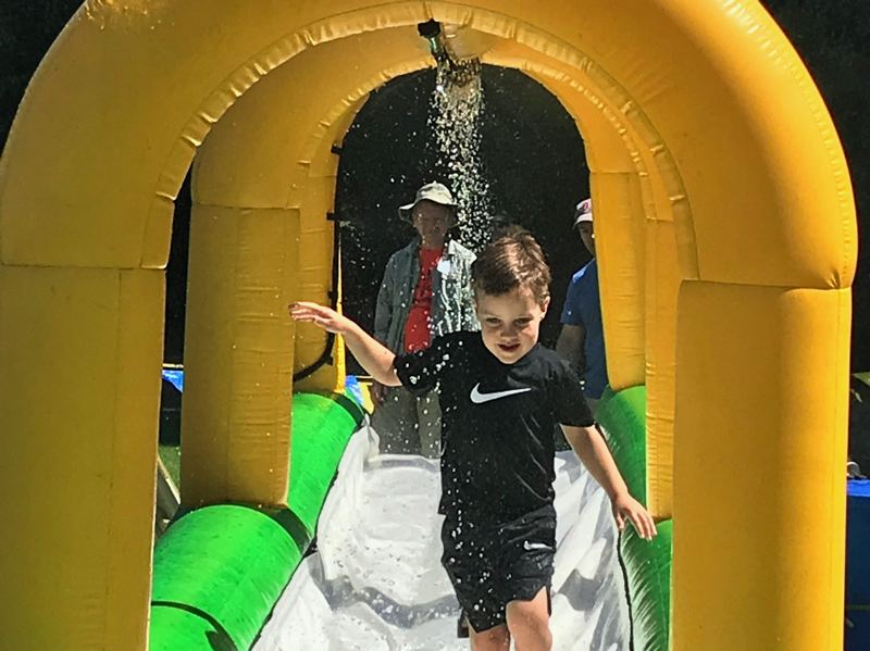 TIMES PHOTO: DANA HAYNES - Thomas Shea, an incoming first-grader at Terra Linda Elementary School in Beaverton, shakes off Sunday's blistering heat by way of a watery walkway.