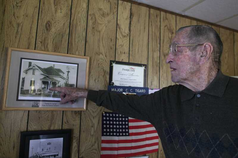 TIMES FILE PHOTO: JAIME VALDEZ - Curtis Tigard points to the family's old homestead during an interview with the Tigard Times when he was 101 years old.