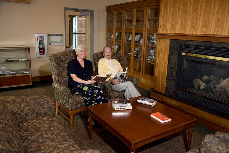 COURTESY TIGARD PUBLIC LIBRARY - Margaret Barnes, Tigard Public Library director, and Curtis Tigard sit in the Grace Tigard Houghton Reading Room at the library, named after Tigard's sister