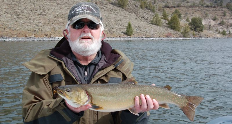PAMPLIN MEDIA GROUP FILE PHOTO  - John Garrison of Sun River holds a 25-inch bull trout he caught on Lake Billy Chinook in 2015. A lawsuit filed Friday charges federal agencies with neglecting to protect the species in Oregon from toxic pollutants.